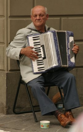 Accordion player on a street corner in Firenze